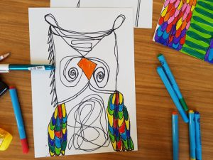 Drawing of a crazy owl using continuous lines and coloured pens.